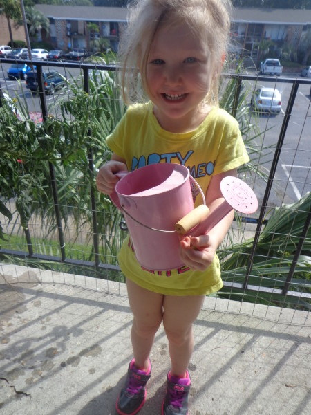 My daughter, Abby, watering the flowers for me.