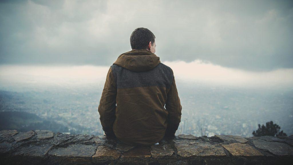 man sitting on ledge
